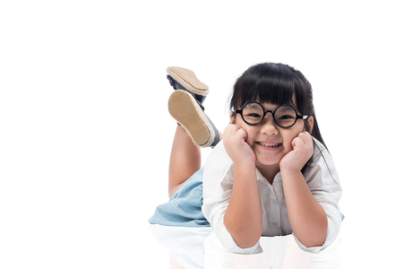 asian children: Little Asian cute girl laying on the floor with smile emotion on face isolated on white background with clipping path. Stock Photo