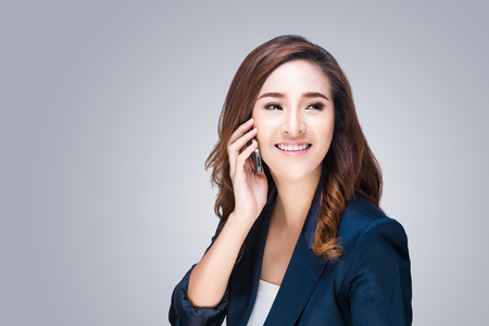 Beautiful young woman with mobile phone making a phone call photo