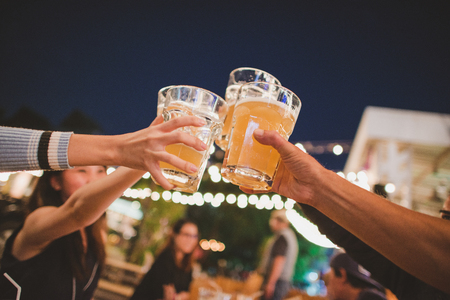 Cheers to the best friends,Group Of Friends Enjoying Evening Drinks,vintage style. Stock Photo