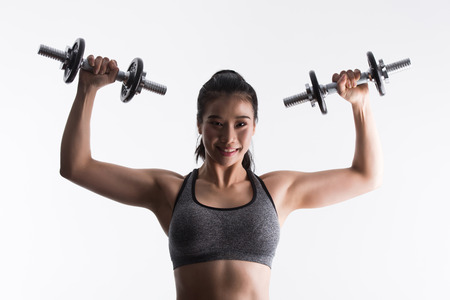 Sporty young woman with dumbbells,sport, fitness, bodybuilding on white background,