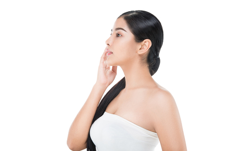 Beautiful woman cares for the skin face - posing at studio isolated with clipping path,asian Beauty.