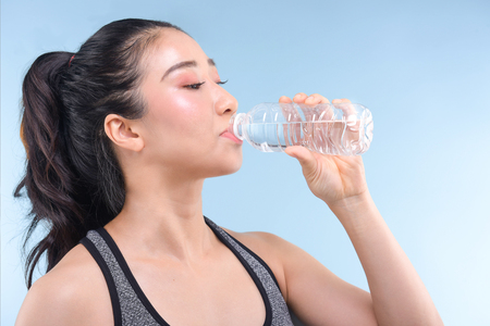 Portrait Of Attractive Woman With Bottle Of Water