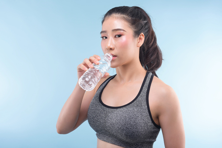 Portrait Of Attractive Woman With Bottle Of Water,Drinking water from bottle. 스톡 콘텐츠