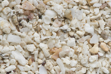 Sea pebble. Colorful small pebble and stone texture. Detailed sand texture.