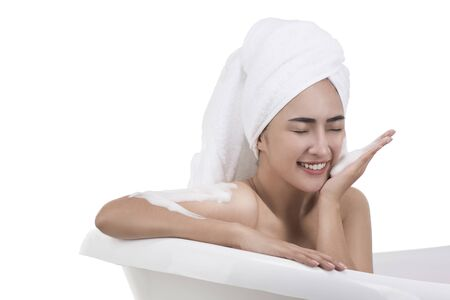 Asian Woman washing face in bath with foam isolated on white
