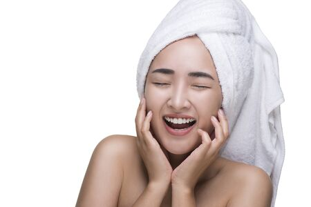 Beautiful Young Woman After Bath Touching Her Face