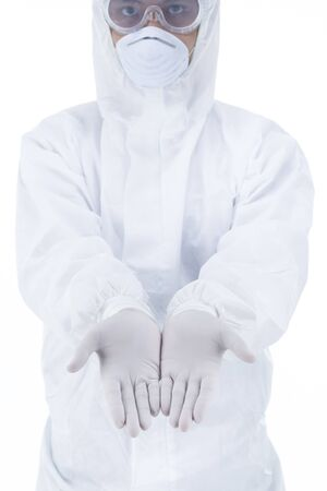 Doctor with protective clothing presenting blank palm of her hand holding something copy space