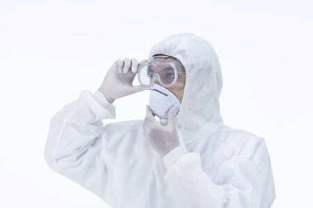 a doctor wearing protective suit to fight coronavirus pandemic covid-2019 on white background.