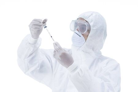 Doctor in protective clothes is holding virus vaccine,Pandemic, epidemic, vaccination concept, depth of field Focus on hand.