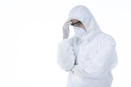 Tired doctor with protective clothing because of coronavirus on white background,tiredness, sadness, crying concept.