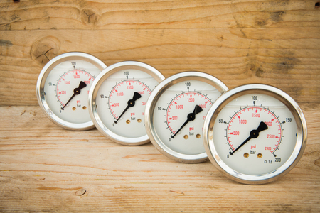 gauges: Pressure gauges on wood background Stock Photo