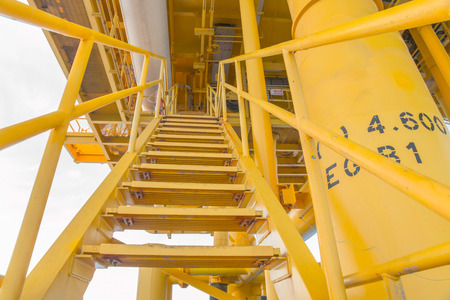 wellhead: Ladder and hand rail on  offshore wellhead platform, Oil and gas platform in the gulf or the sea, Petroleum exploration and production industry