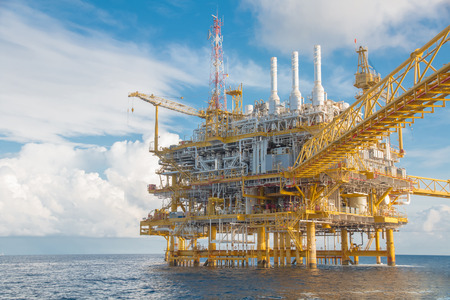 Oil and Gas central processing platform on crew boat  view in the gulf of Thailand in blue sky day on crew boat  view in the gulf of Thailand in blue sky day Stock Photo
