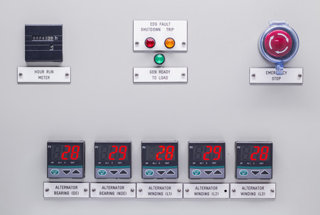 override: Electrical control panel containing has a digital temperature gauge with an emergency push button switch shutdown .