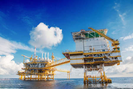 Oil and Gas central processing platform on crew boat  view in the gulf of Thailand in blue sky day