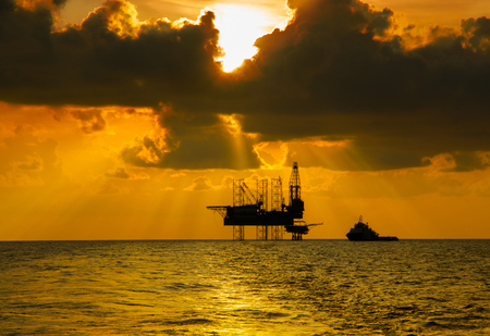offshore jack up rig: Offshore Jack Up Rig in The Middle of The Sea at Sunset Time Stock Photo