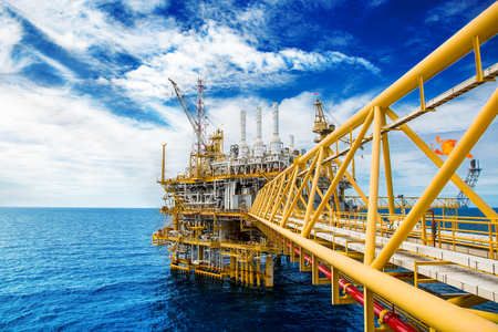 Oil and gas platform or Construction platform. power business concept. offshore rig plant. energy concept. stock investment Archivio Fotografico