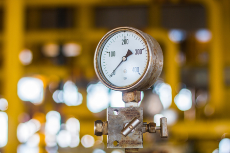 Presssure gauge in oil and gas flatform, selective focus, soft focus, blur background