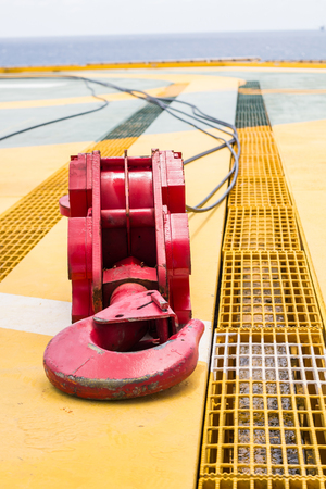 Crane hook,Red crane hook with steel ropes on the floor during inspection