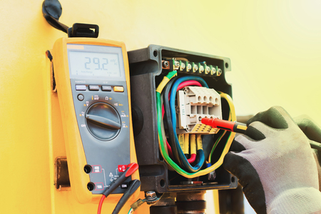 electrician,Hand of electrician on the job function check electical system Stok Fotoğraf
