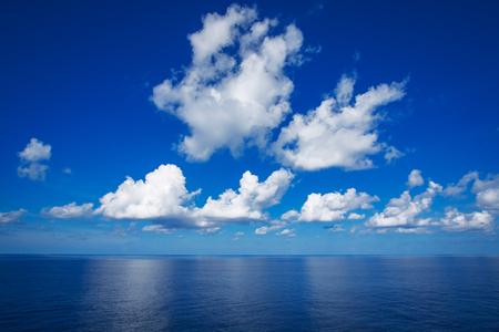 Blue sky with white clouds reflex on the sea. Stok Fotoğraf