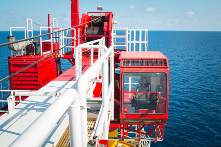 Crane control cabin, Pedestal crane winch, Steel wire rope on production platform, Energy and petroleum industry Stok Fotoğraf