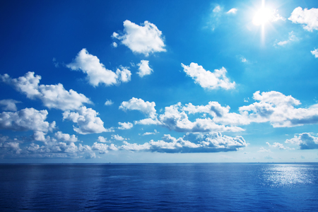 White cloudy with blue sky on the sea as background Stok Fotoğraf