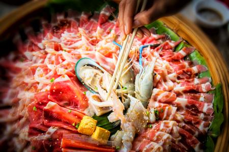 raw slice pork , egg and sea food  for shabu