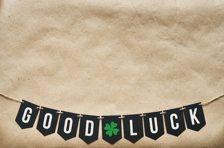 banner craft: GOOD LUCK banner lettering on eco craft paper background.