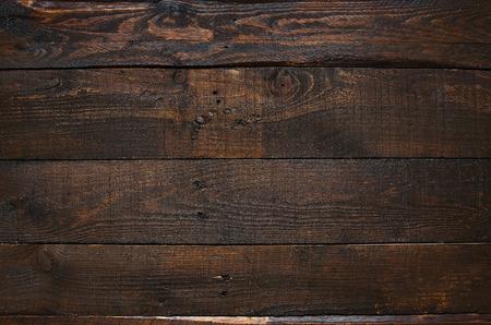 Dunkelbraun rustikal im Alter von Scheune Holzplanken Hintergrund. Standard-Bild