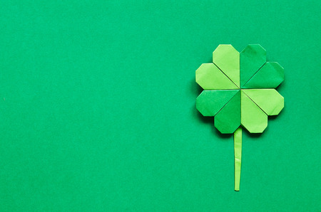 shamrock: Green origami shamrock clover leaf paper background. Stock Photo