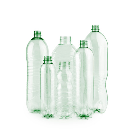 Six diverse new unused green empty plastic bottles without caps on white background cut out.