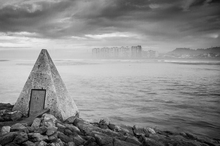Pyramid crowning the viewpoint of the beach of salinas in asturias Stock Photo