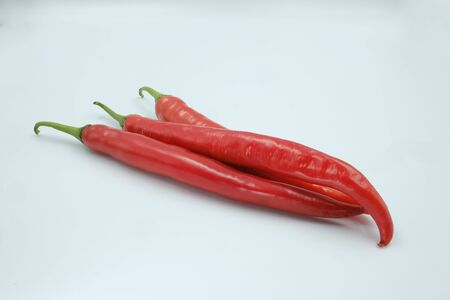 Fresh whole red chili peppers on the white background, organic ingredient for healthy, hot and spicy to help burning fat Reklamní fotografie