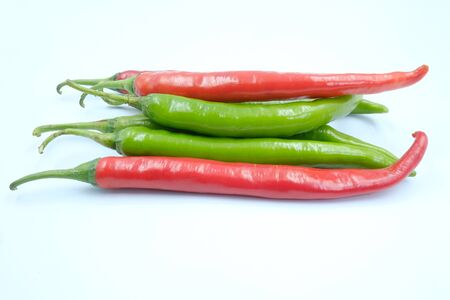 Fresh green and red chili peppers on the white background, organic ingredient for healthy, hot and spicy to help burning fat
