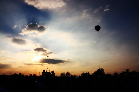 Balloon festival in beautiful sunset photo