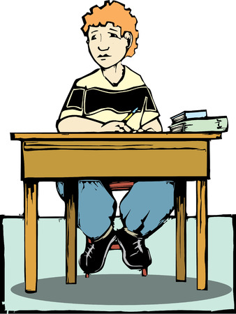 school class: Boy sitting at desk.