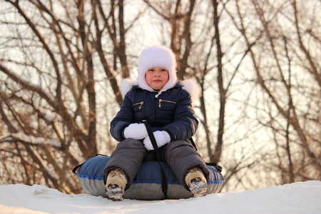 girl rides snow tubing Stock Photo