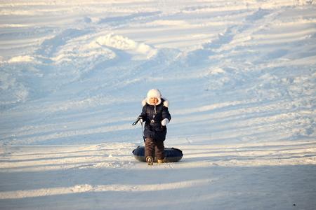 tubing: girl rides snow tubing Stock Photo