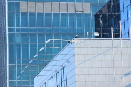 strut: glass skyscraper against a beautiful blue sky