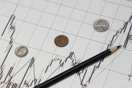 dow: pencil, coins and banknotes. Dow Jones index. currency rates on Forex Stock Photo
