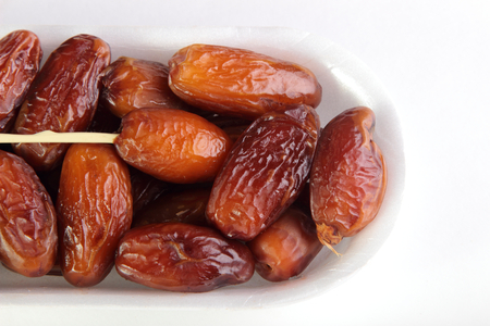 dates on white background. healthy eating vegetarianism Stock Photo