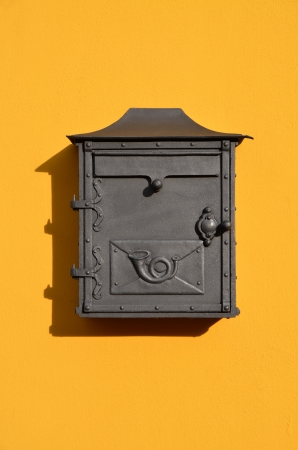 Decorative letterbox on the yellow wall of the building  Cesky Krumlov, Czech Republic