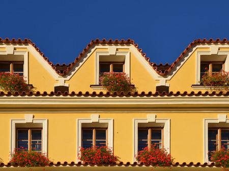 European yellow house facade. Prague, autumn