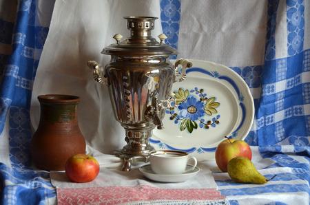 Russian still life with samovar. kitchen utensils, fruits