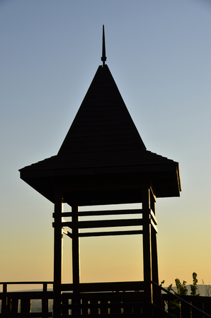 Silhouette house on a background of the sky, sunset. Stock fotó