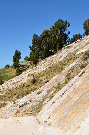 Rocky cliff. Sunny day on Lake Titicaca, Bolivia