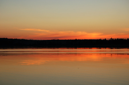 A beautiful sunset on the lake. Russian summer