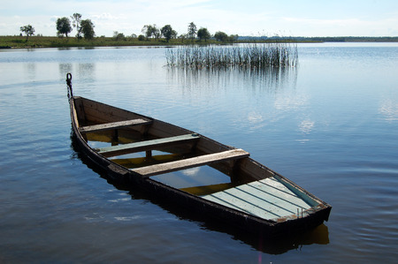 Old boat on the water. River. Summer