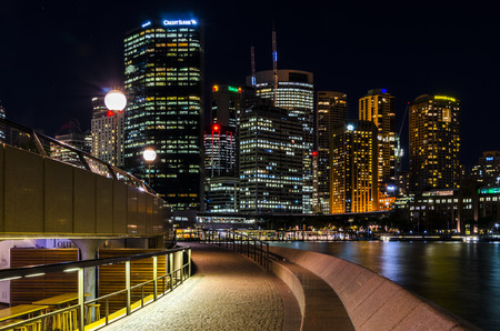 new south wales: View of Sydney Skyscrapers at night. Skyscrapers reflections in water, Sydney, New South Wales, Australia.
